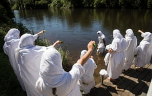 Mandaean faithful conduct baptism rituals in the Georges River in south-western Sydney.