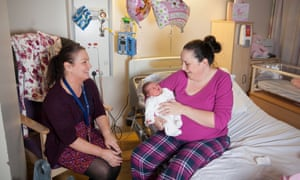Gill Houghton, consultant midwife with Nicola Gannon and her baby Heidi Rose at Liverpool Women's Hospital.