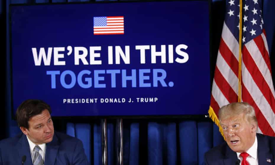 Ron DeSantis, the Florida governor, at a coronavirus briefing with Donald Trump at the end of July. This week the state surpassed half a million confirmed cases.