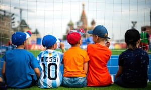 Young fans in Red Square on the eve of the World Cup final.
