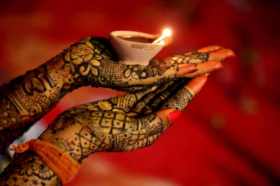 A bride performs a ceremony before her wedding in Bhopal.