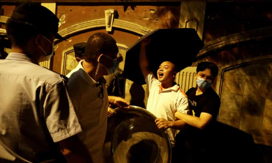 A protester shouts pro-China slogans outside the US Consulate General in Chengdu