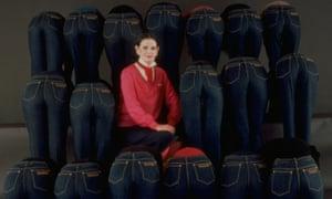 Jeans that 'really hug your derrière' … Gloria Vanderbilt sitting amidst a group of models in her designer jeans.