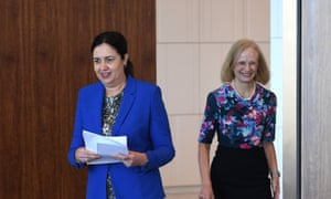 Queensland premier Annastacia Palaszczuk and chief health officer Dr Jeannette Young arrive at their press conference in Brisbane
