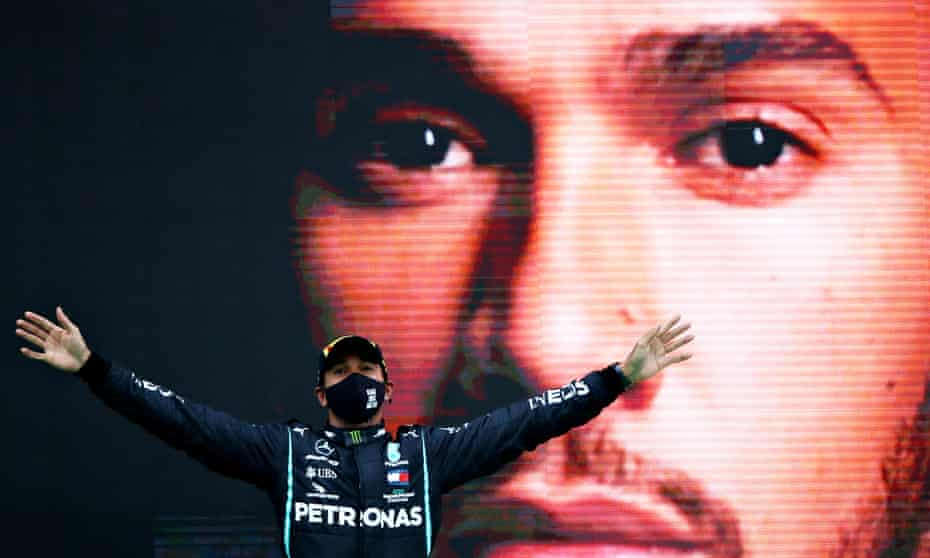 Lewis Hamilton celebrates his record-breaking 92nd race win on the podium during the F1 Grand Prix of Portugal at Autodromo Internacional do Algarve