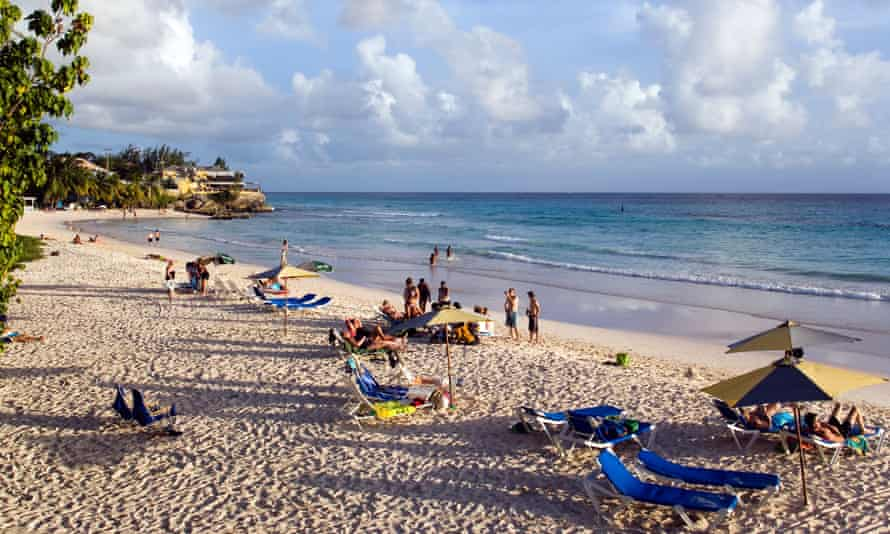People relaxing at Accra Beach, Rockley, Barbados. Caribbean nations will be hit hard by the pandemic.