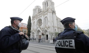 French police officers guard the Notre-Dame Basilica after the knife attack.