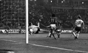 Sergio Ahumada, right, scores for Chile 1-1 draw with East Germany at the 1974 World Cup. Véliz, No11, watches on as the ball goes past the diving Juergen Croy