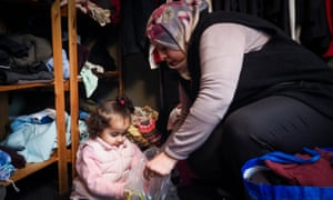 Farah Alhrahshi, three, with her mother Kafa at the West End Refugee Service.