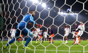 Anthony Lopes is helpless to stop Sergio Agüero from equalising with a header.