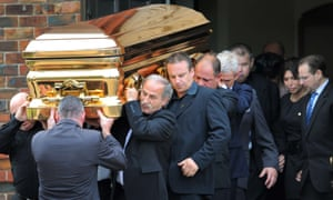 Carl Williams' widow Roberta follows his coffin at his funeral in Melbourne in 2010