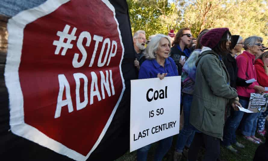 People protest against Adani's Carmichael coalmine outside the Indian high commission in Canberra.