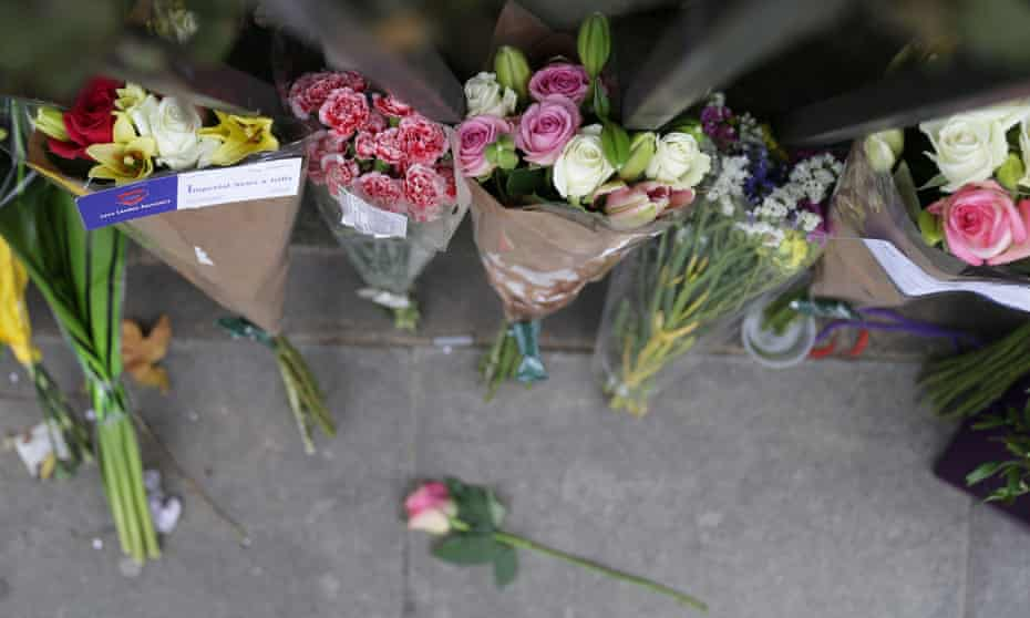 Floral tributes in Russell Square, London on 4 August after an overnight stabbing spree that left one woman dead and five other people injured.