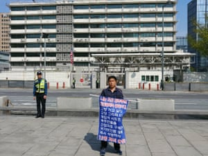 Kwon Chol-nam staging a one man protest outside the US embassy in central Seoul asking to be allowed to return to North Korea.