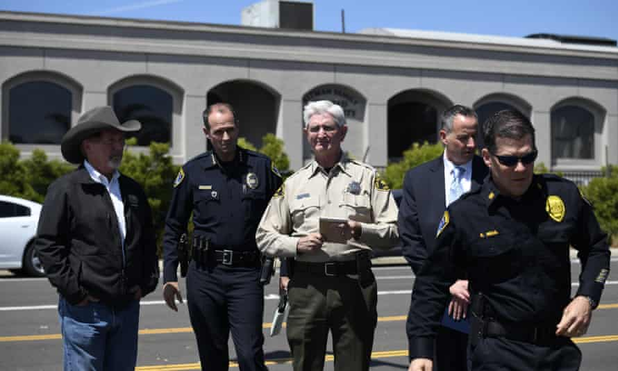 San Diego county sheriff Bill Gore, center, arrives with other law enforcement officials outside of the Chabad of Poway synagogue.