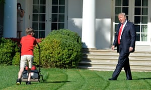 Donald Trump watches Frank Giaccio, 11, as he mows the lawn in the Rose Garden