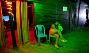 A sex worker waits for customers in La Pampa, in Peru's Madre de Dios region.