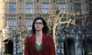 MP Layla Moran stands outside the Houses of  Parliament.
