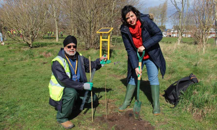 Bali Singh Panesar, of Sikh Union Coventry, and Nav Mann, a Coventry 2021 UK city of culture official, plant trees in the city.