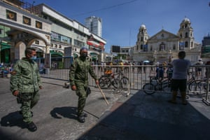 Police patrol as Roman Catholic devotees gather in front of Quiapo church during Good Friday in Manila on 2 April