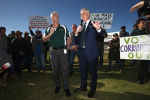 "The National party member for Nicholls, Damien Drum, and the deputy prime minister and Nationals leader, Michael McCormack, talk to farmers and protesters from the ""convoy to Canberra"" this morning."