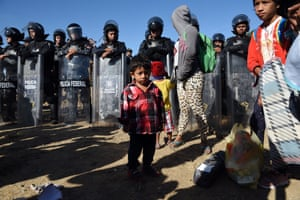 Members of the migrant caravan arriving at the border with the US, were met by a line of Mexican police in riot gear in Tijuana, Mexico