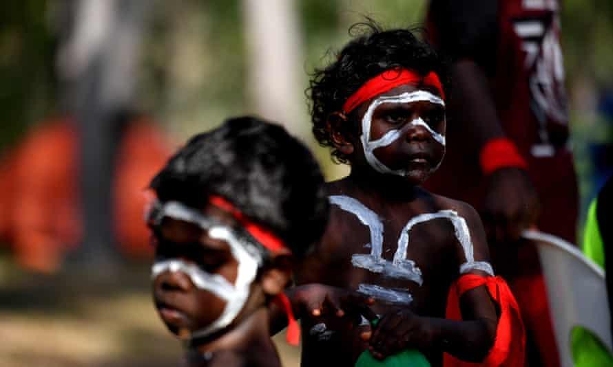 First Nations children in ceremonial dress