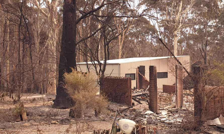 Ron Weir's bushfire-resilient home in Rosedale, on the NSW south coast, designed by architect Thomas Caddaye, is intact while neighbouring homes burned down.