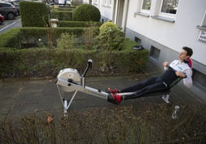 Malte Jakschik, a rowing world champion with the German eight-man crew, trains in front of his Dortmund apartment.