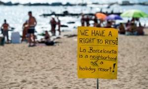A placard on the beach at La Barceloneta, Barcelona