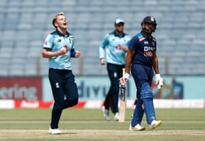 England's Sam Curran celebrates the wicket of India's Rohit Sharma.