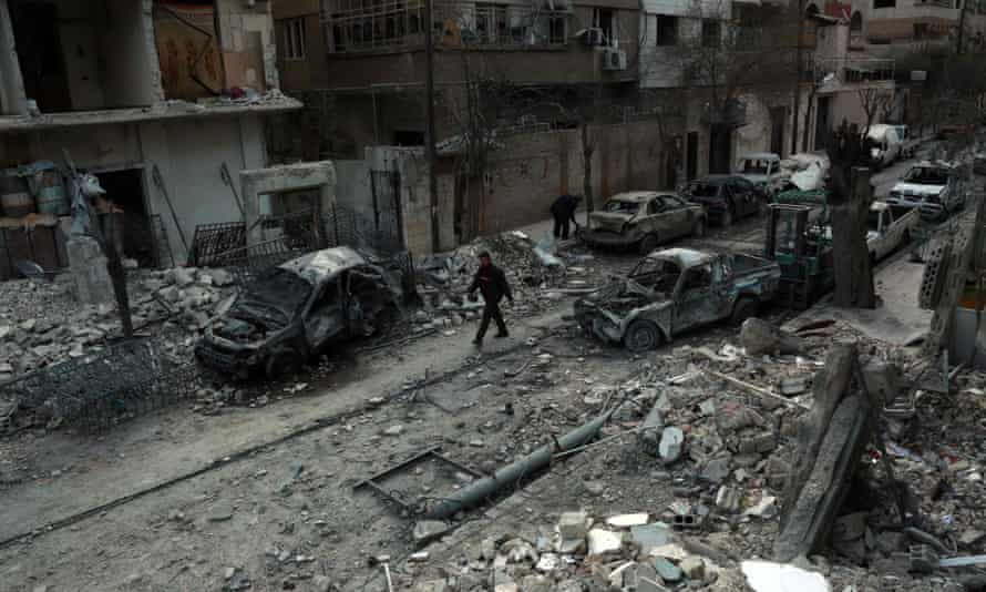 Damaged buildings in eastern Ghouta on Sunday following regime air strikes.