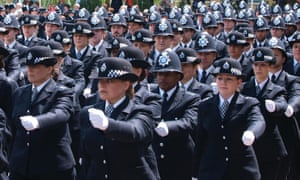 Police officers take part in the passing out ceremony at the Hendon police academy.