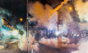 Hong Kong Police fire teargas during an anti-extradition bill march in Hong Kong on Sunday.