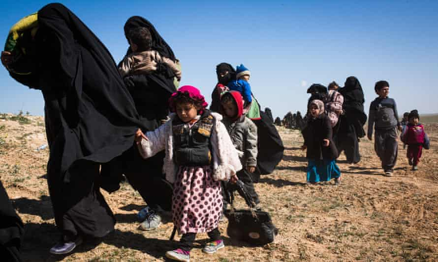 Women and children fleeing Baghuz, the last remaining Isis enclave in Syria.