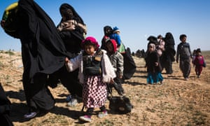 People leaving Baghuz in Syria after Islamic State's caliphate crumbled in February 2019.