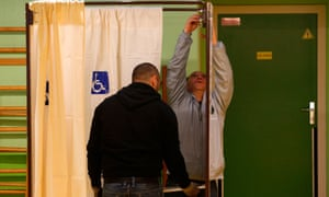 A wheelchair-accessible voting booth is set up at a polling station in the French presidential election. In the UK one in four disabled people found polling stations inaccessible at the last general election.