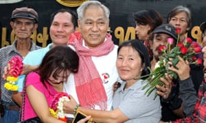 Thai political activist Surachai Danwattananusorn is hugged by his family after his release from Bangkok prison in 2013.
