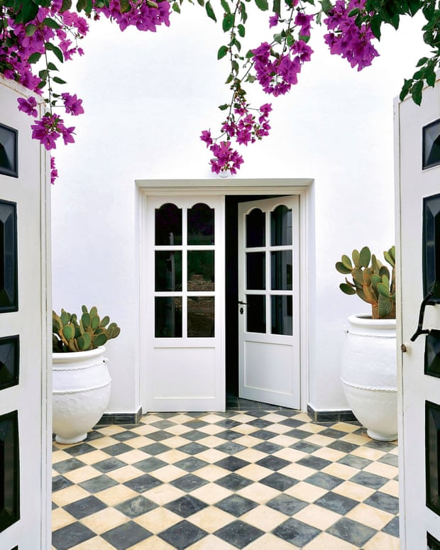 The large central courtyard with its chequerboard floor (find similar at wallsandfloors.co.uk)