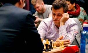 The reigning champion, Magnus Carlse,n stares at the board during the 2018 World Chess Championship