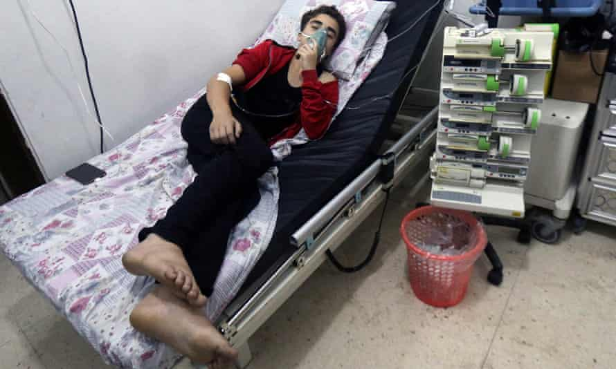 A civilian breathes through an oxygen mask after an alleged chlorine gas attack in Aleppo.