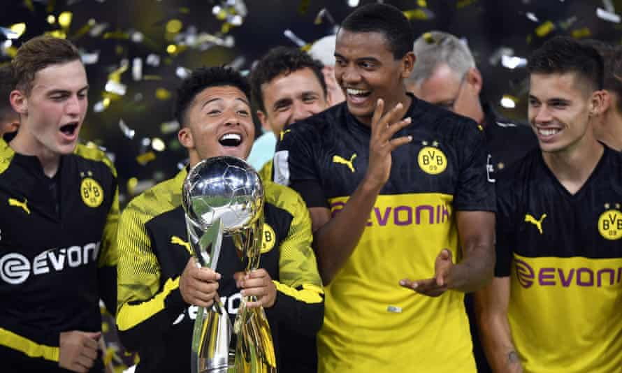 Jadon Sancho lifts the trophy after inspiring Borussia Dortmund to victory in the German Supercup.