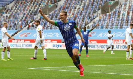 Wigan Athletic's Kieran Dowell celebrates scoring his sides eighth goal while Hull's players are disconsolate