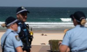 Police officers patrol Bondi Beach prior to its closure in Sydney