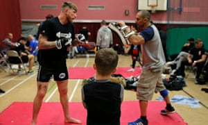 A young boy watches fighters warm up before their BCMMA fight.