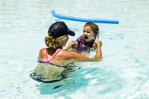 Jennifer Vollmann, 33, plays with her two-year-old daughter, Izela, in a pool in Phoenix, Arizona, on Thursday 15 June. Vollmann, who lives in Phoenix, said her daughter will be back in the pool next week when temperatures are expected to hit 120F