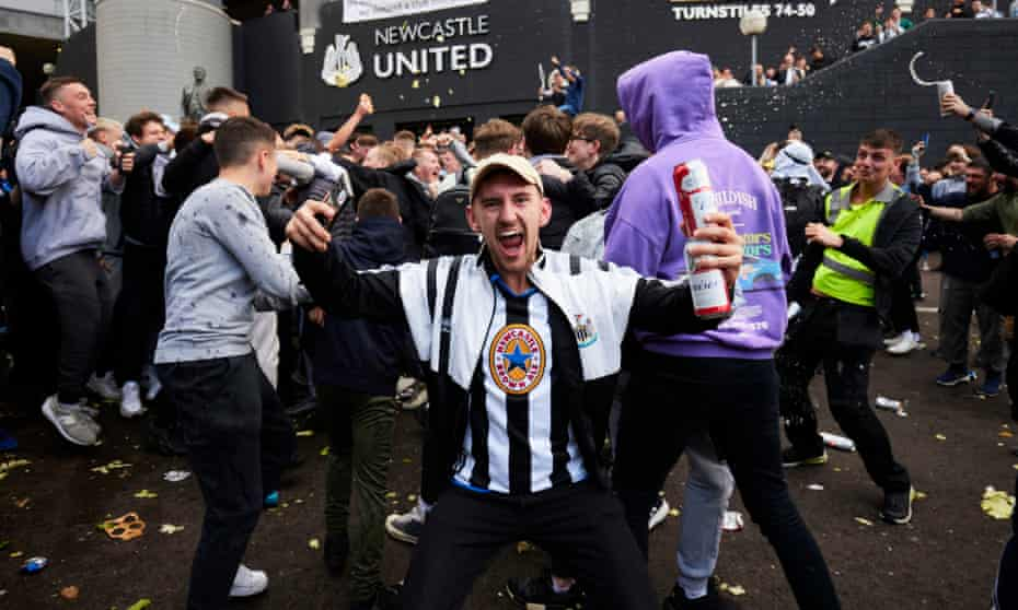 Newcastle fans celebrate outside St James' Park after confirmation of the club's takeover