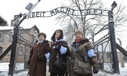 Auschwitz survivors stand outside the camp in January 2015, on the 70th anniversary of its liberation.