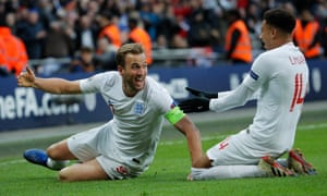 Harry Kane celebrates his late winner at Wembley.