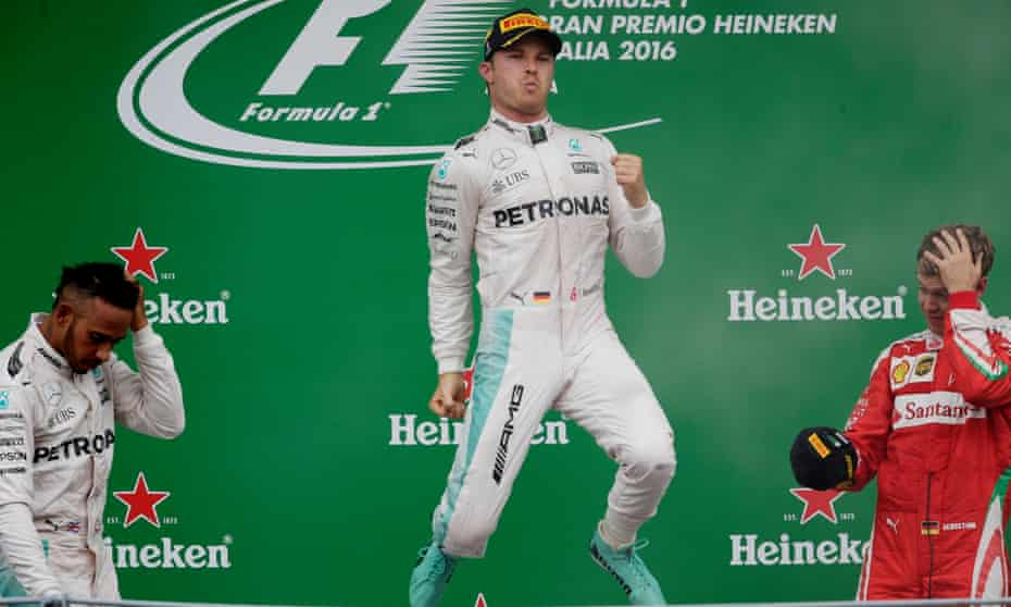 Nico Rosberg, flanked by Mercedes team-mate Lewis Hamilton and third-placed Sebastian Vettel, celebrates his win at Monza